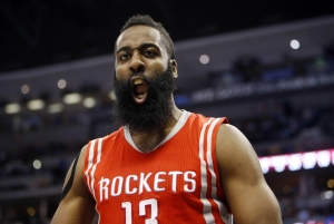 Mar 7, 2015; Denver, CO, USA; Houston Rockets guard James Harden (13) reacts during the second half against the Denver Nuggets at Pepsi Center. The Rockets won 114-100. Mandatory Credit: Chris Humphreys-USA TODAY Sports